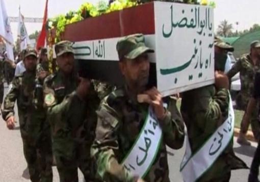 صورة شوارع العراق تكتظ بصور مقاتلين قضوا في سوريا