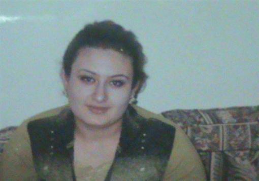 صورة امرأة كردية توفيت اثر الضغط النفسي بعد مقتل زوجها امامها