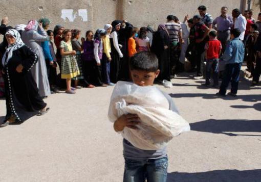 صورة ازمة انسانية في حي الاشرفية ووصول سعر رغيف الخبز ل 500 ليرة