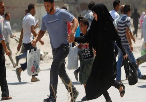 صورة قناصة مجهولون يطلقون النار على مفتشي الكيماوي في معضمية الشام