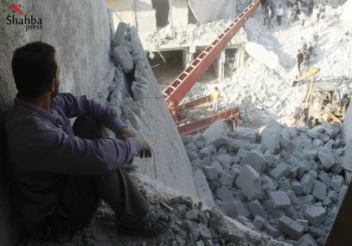 صورة آثار القصف على حي الفردوس