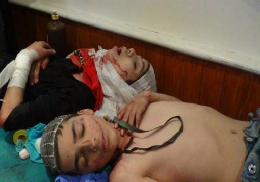 """صورة مرشح الهولوكوست """" أسد """" يقتل أطفال مدرسة عين جالوت بحلب"""