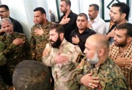 صورة مجندة روسية وضابط إيراني في قبضة ثوار درعا