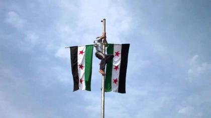 صورة حملة لتوحيد راية الثورة ورفع علمها من جديد