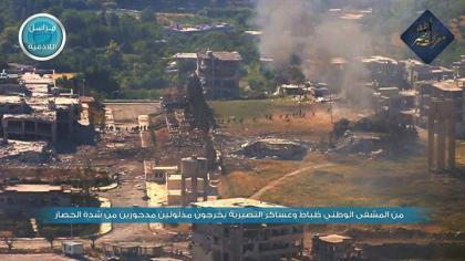 صورة مليشيا الأسد تهرب من مشفى جسر الشغور