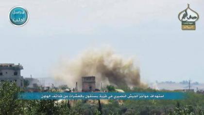 صورة ثوار فتح إدلب يشنون هجوماً على حواجز الأسد بالقرب من محمبل