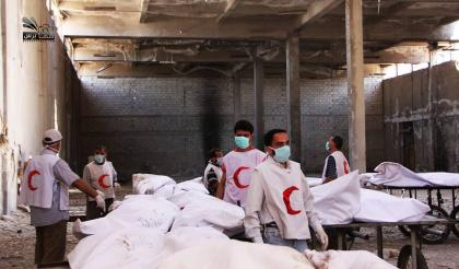 صورة عملية تبادل بين الثوار وقوات الأسد بوساطة الهلال الأحمر