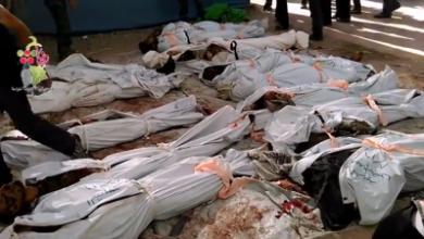 صورة مئة شهيد في دوما بريف دمشق